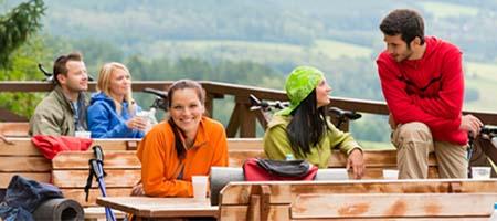 Talking friends enjoying mountain view rest place